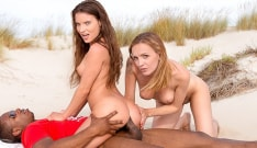 Anita Bellini and Belle Claire in an interracial anal threesome on the beach